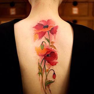 Sexys y Delicados Tatuajes con Flores para Mujeres